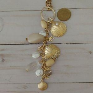 "Chico's seashell goldtone 20"" drop necklace"